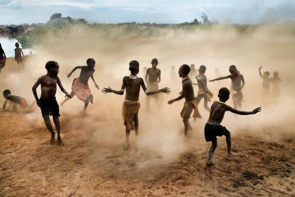 children playing in dust