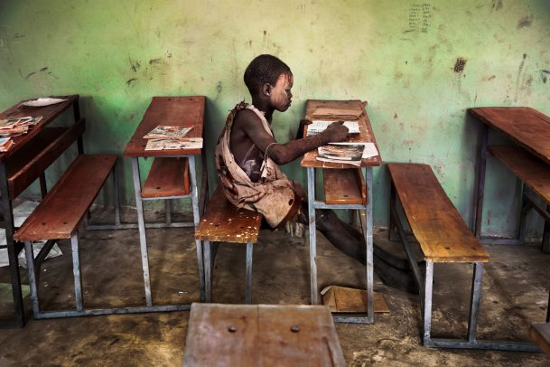 A child studies in a classroom