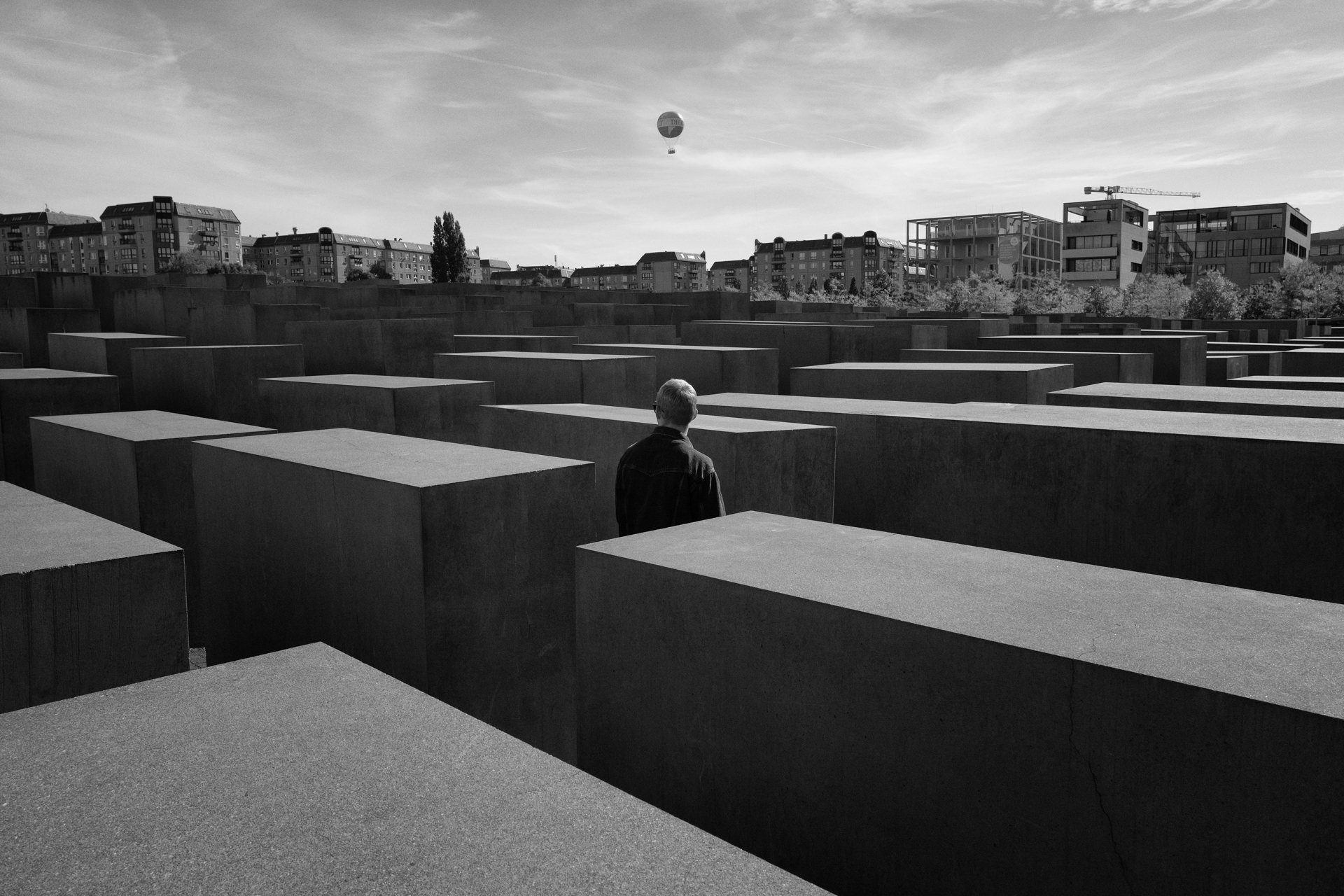 man in the Memorial to the Murdered Jews of Europe in Berlin