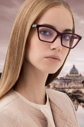 woman wearing glasses with Saint Peter in Rome on the background