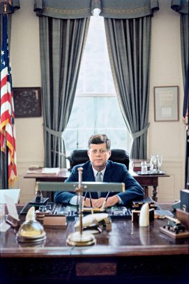 President John F. Kennedy in his office