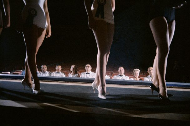 legs of three girl while a jury watch them