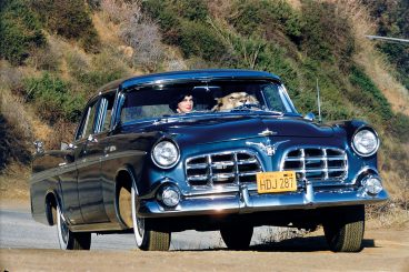 woman with a lion in a fifties blue car