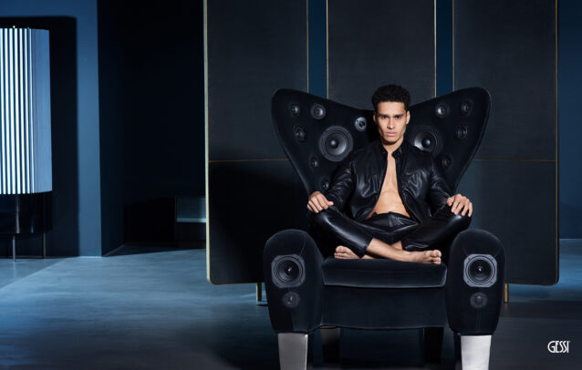 a man on an armchair with speakers for Gessi by Susi Belianska