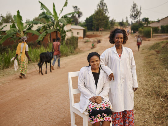 two doctors next to each other in an ethiopian street for Novartis annual report by Joey L.