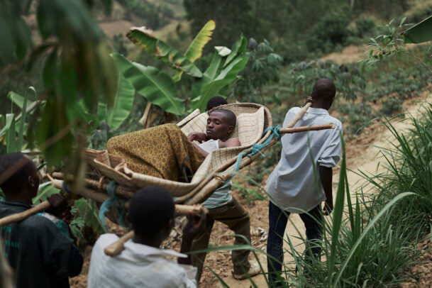 a patient being trasported by four men in the forest during Novartis annual report by Joey L.