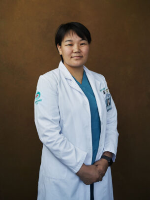 mongolian doctor posing for Novartis annual report by Joey L.