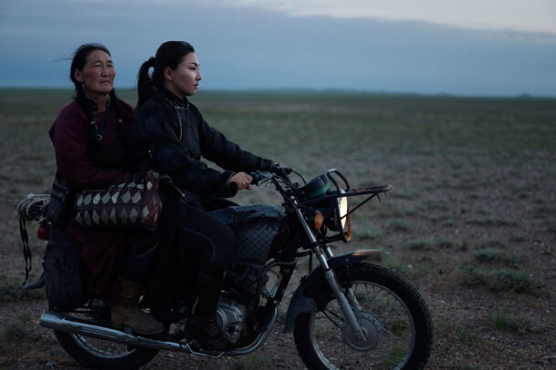 two women on a motorcycle in Mongolia