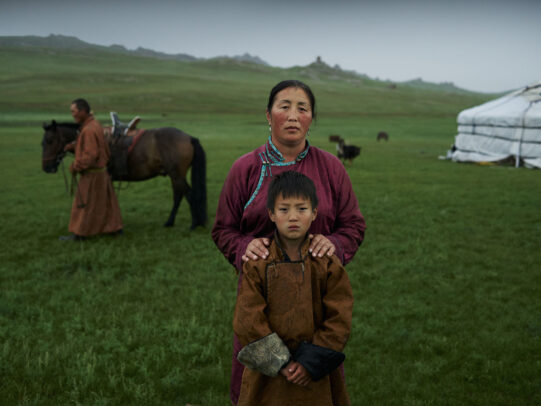 a mongolian woman and a child posing for Novartis annual report by Joey L.