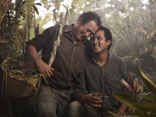 Father hugging his son in the middle of a coffee plantationfor Lavazza Calendar 2016 by Joey L