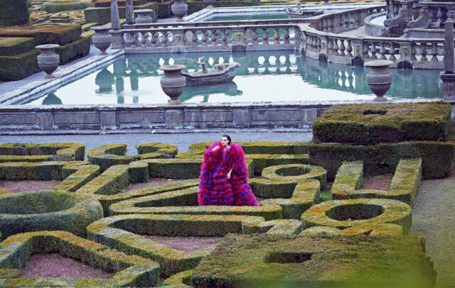 woman with long pink dress in a garden of Villa Lante