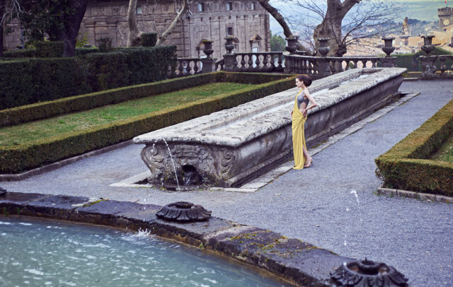 woman with long yellow dress in the garden of Villa Lante