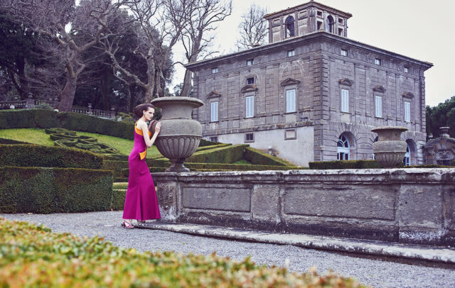 Woman with long pink dress in the garden of Villa Lante