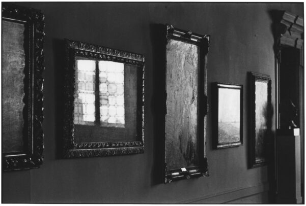 reflection of light on the glass of paintings