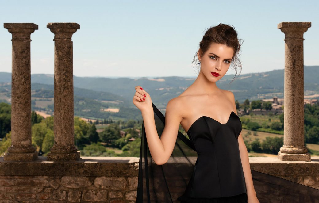 a girl in black dress in an italian landscape for Astra Make Up by Susi Belianska