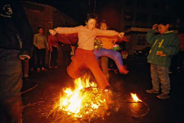 children jumping on the fire at the end of new years celebration