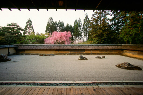 a japanese garden with rocks and sand