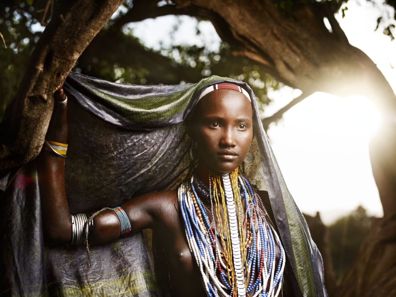 ethiopian girl with traditional dress in the Omo Valley by Joey L.