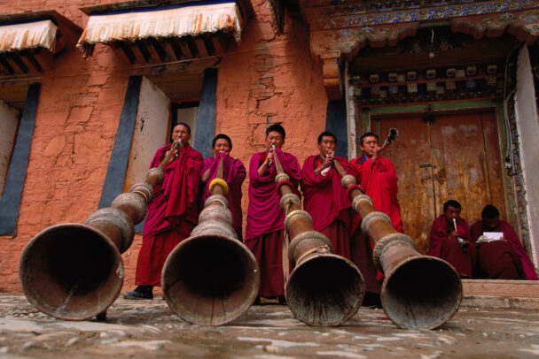 monks using the traditional 13-foot horns