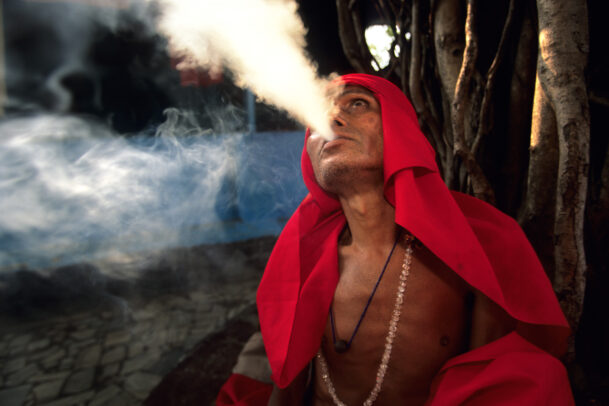 man with a red veil smoking