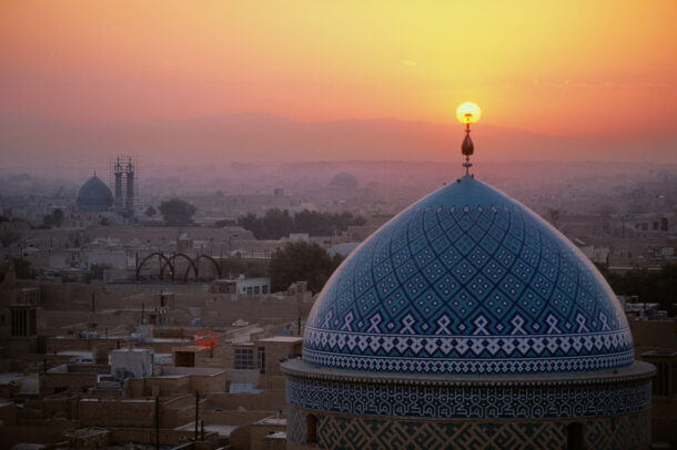 Sunset inflames the crescent symbol atop the dome of the Jame Masjid.