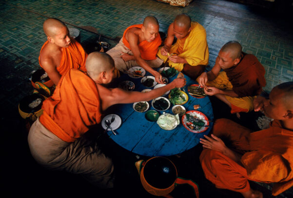 Young monks share a communal breakfast