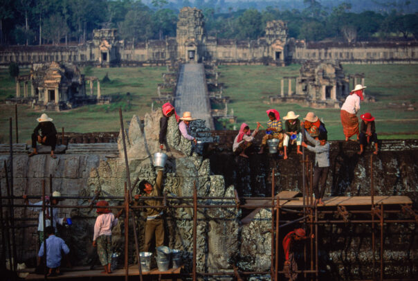 men working on a scaffolding in Angkor Wat
