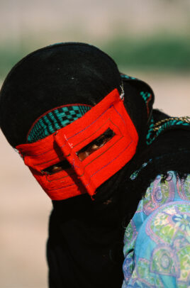 woman with black and red masks