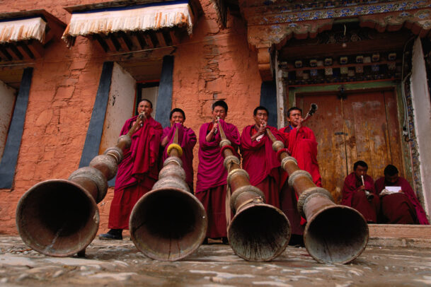 Music lesson for Labrang's monks using the traditional 13-foot horns.