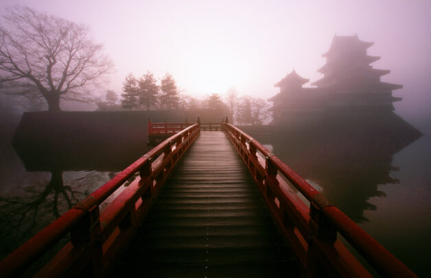 A bridge leading to a mist-veiled Castle in Matsumoto, one of the best preserved fortress from the samurai's reign.