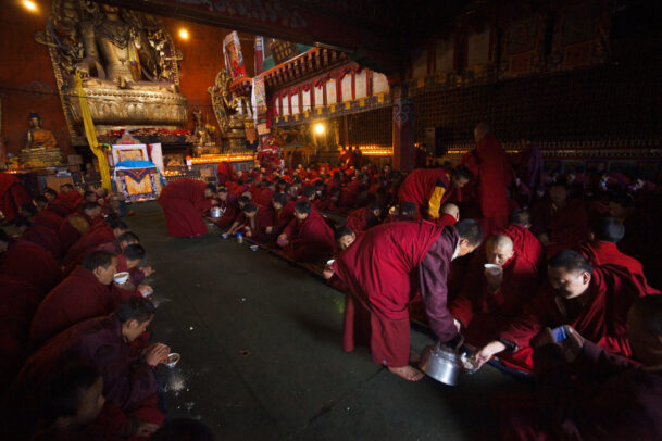 At Shechen monastery in Sichuan Province, monks mix tea into tsampa, roasted barley flour, to make a meal