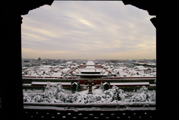 the forbidden city in Beijin covered in snow