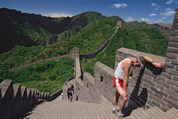 A marathon runner taking breath on the great wall