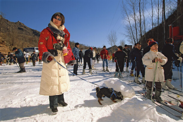 woman with his dogs at the Huaibei International ski resort in the Jiugukou natural scenic area