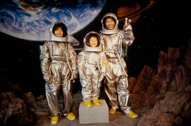 a japanese family posing in space suits