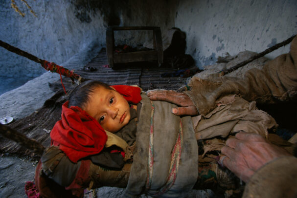 A child sleeps in a hammock