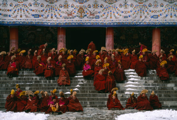 monks on the stairs of a monastery