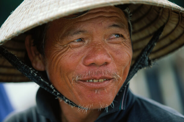 A smiling fisherman in Da Nang on the Vietnamese coast.
