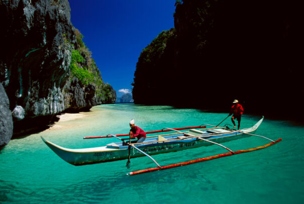 a boat in a crystalline beach of Philippines