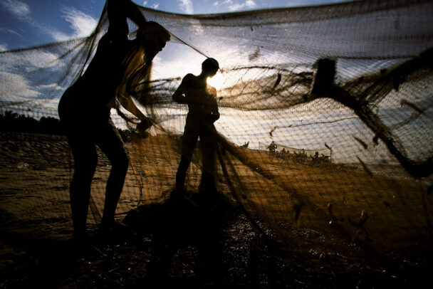 men cleaning nets