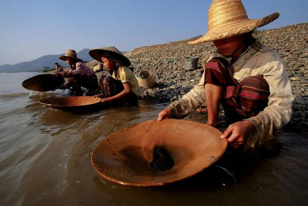 girls prospecting for gold along the banks of the Mekong