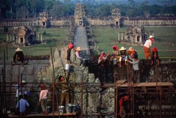 men working on a scaffolding in Angkor Wat