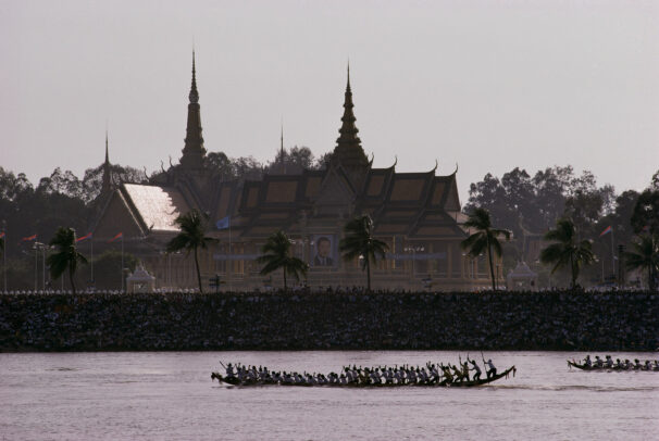 men competing in a pirogue races on Mekong River