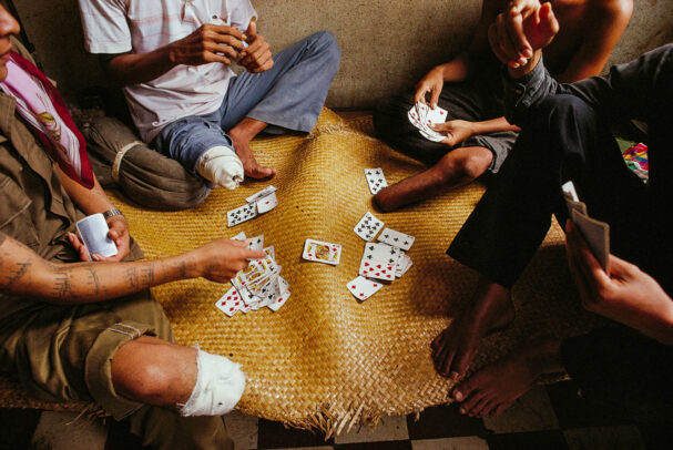 men with amputated legs playing cards