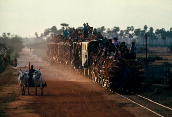 train overloaded with people on the top