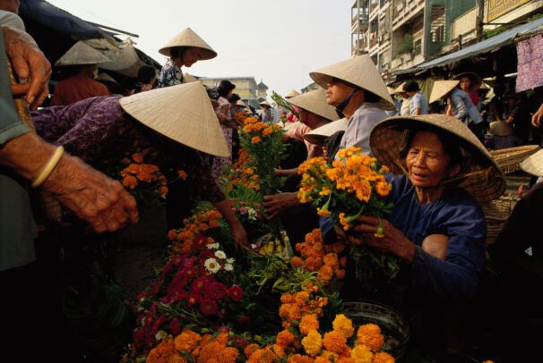women selling and buying flowers in Vietnam