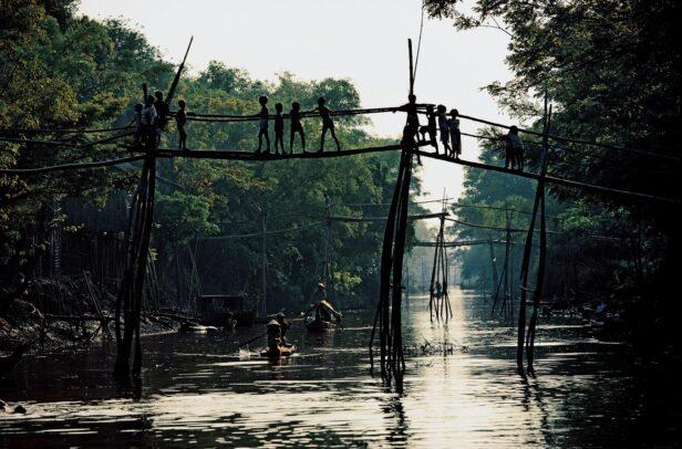 children on a monkey bridge in Vietnam