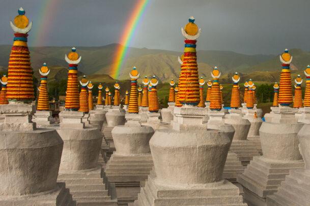 rainbow over stupas