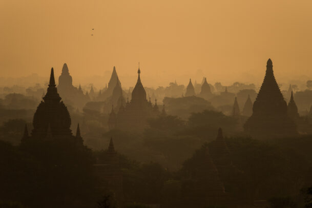 Temple spires silhouetted in Bagan