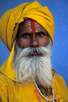 Sadhu holy man with yellow turban and white beard in Jujarat, India